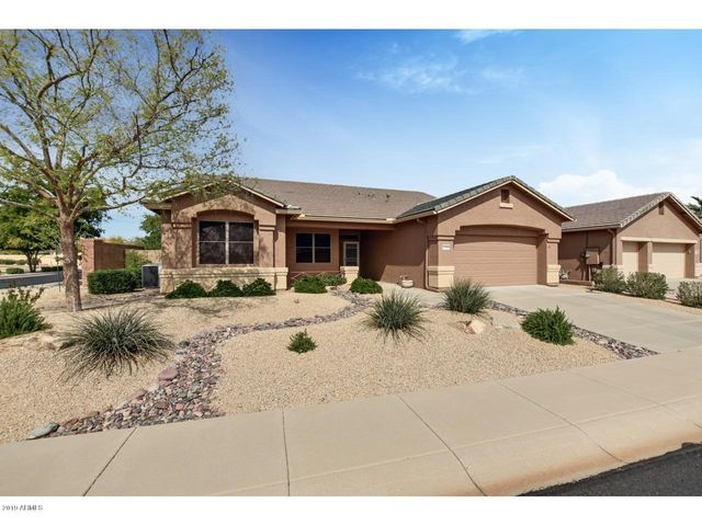 This beautiful home is nestled on a N/S facing lot in the guard gated resort community of Arizona Traditions. It has great curb appeal... but wait until you step inside!