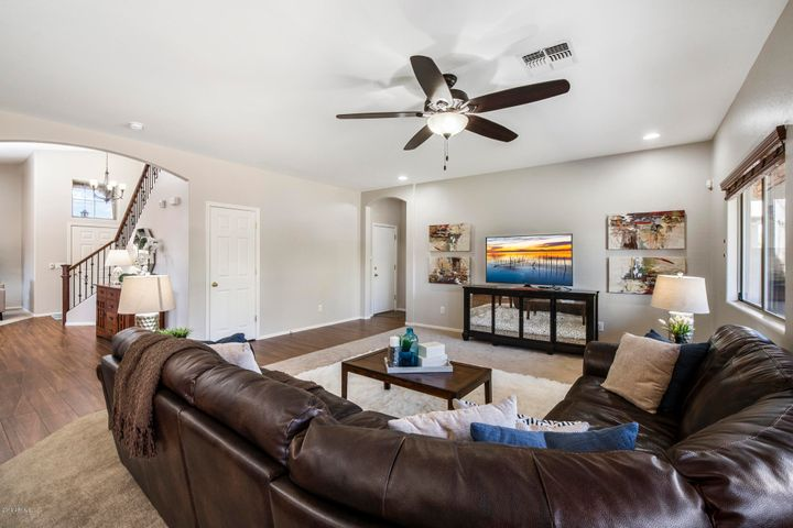 As soon as you walk in the door you are greeted with a formal living and dining room that opens to this Family Room.