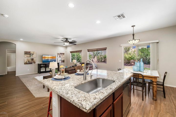 The open flow from the Kitchen to the Family Room is ideal for any family.