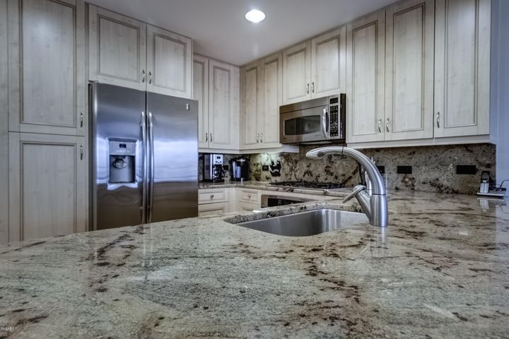 Beautiful granite counters and backsplash