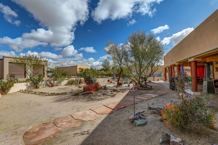 Overview of back yard, patio and RV garage/workshop.