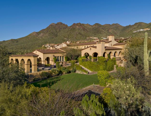 Enjoy privacy, views and quality construction in this custom estate on 2 acres in the desirable Upper Canyon of Silverleaf.