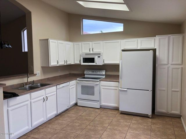 Beautiful kitchen cabinets with large pantry and Fridge