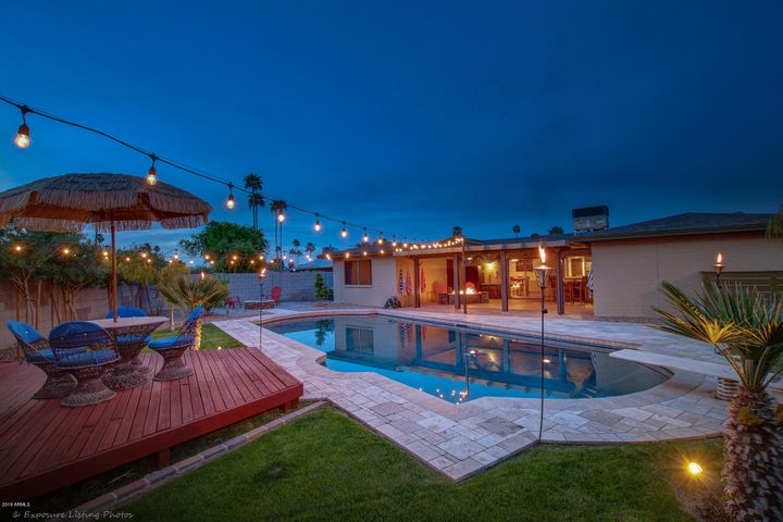 Raised wood deck is great for entertaining near the pool.
