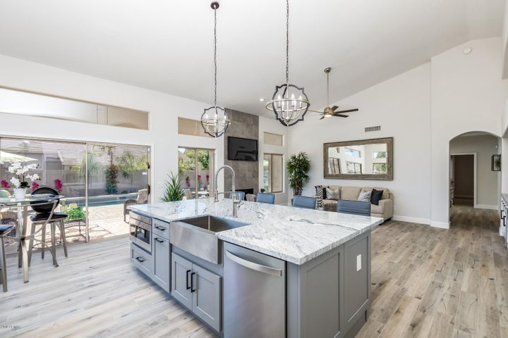 Open kitchen to family room! Just like a massive Great Room! New gorgeous wood look tile, new designer hint of gray paint, new exterior paint too!
