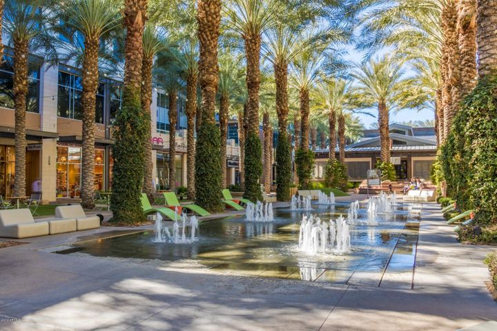 Scottsdale Quarter! The middle has a courtyard with fountains for the children to play in, tables to sit and enjoy, coffee, food and more!