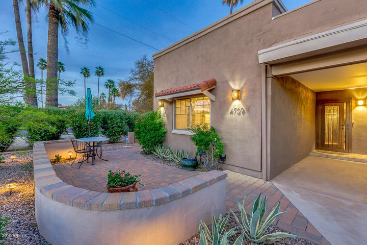 THIS REMODELED, RARELY AVAILABLE CORNER LOT HOME FEATURES FRONT AND BACK PATIOS, SIDE ENTRY TO THE YARD, A TWO CAR CARPORT AND EXTRA WINDOWS ON THE NORTH SIDE OF THE HOME.