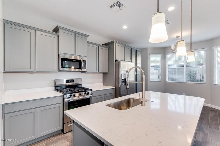 Gorgeous upgraded French grey cabinets. Photos represent same floorplan and interior package.