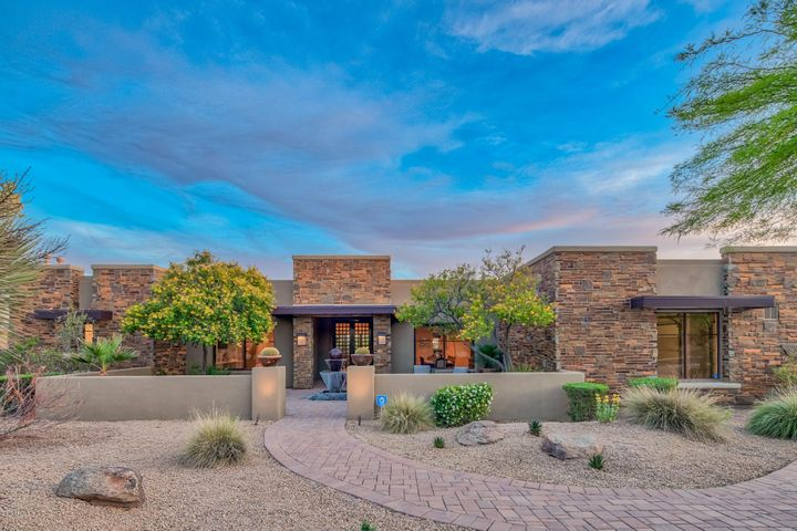 Located in gated Pinnacle Peak Place