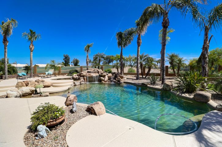 Relax in your backyard oasis complete with a pebble tec finished pool and hot tub and views of the Palm Golf Course.