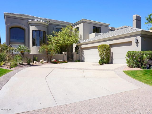 Beautiful Gainey Ranch executive home with 3-car, side-entry garage!