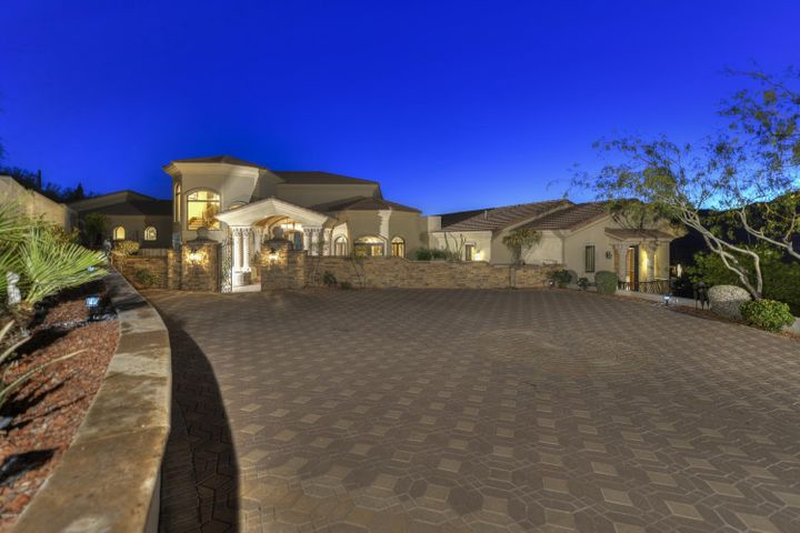 Privately nestled on a hillside lot with panoramic views.