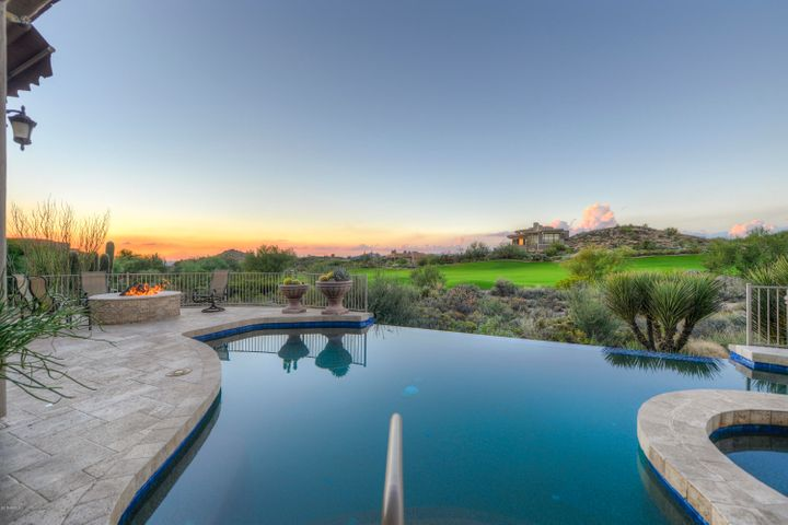 The infinity edged pool adds to the drama of this home's outdoor living area.