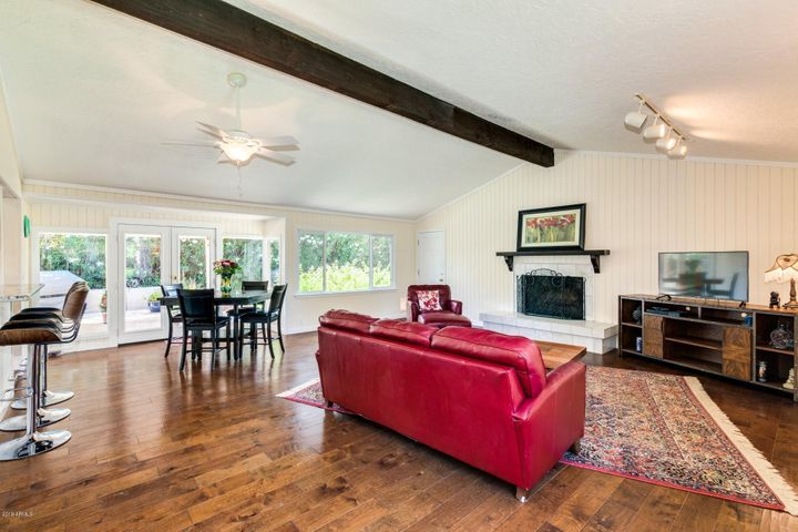 Great Room with Cathedral Ceilings, Marble-faced Fireplace, Dining Area, French Doors