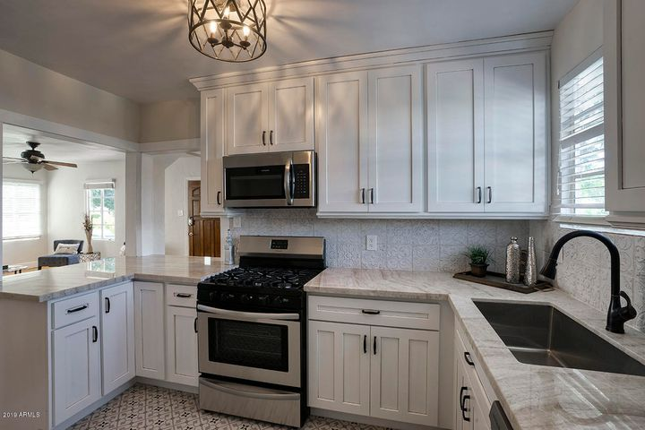 Kitchen is COMPLETELY brand new with custom cabinets, quarzite counters, backsplash, and brand new appliances