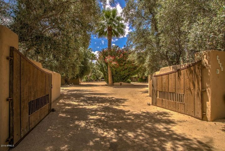 Rustic metal and wooden clad gates welcome you to the timeless design of this Bill Tull sanctuary estate.