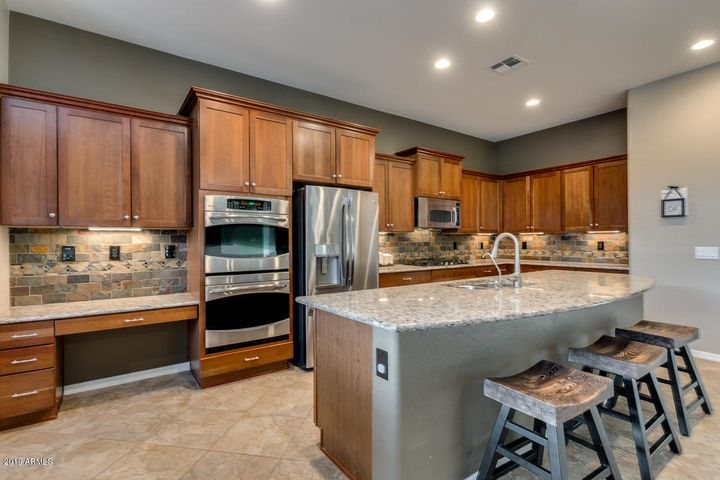 Gourmet kitchen with double ovens and loads of cabinets
