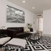 Spacious main living area - open , bright and airy . Large windows afford an indoor/outdoor feel.