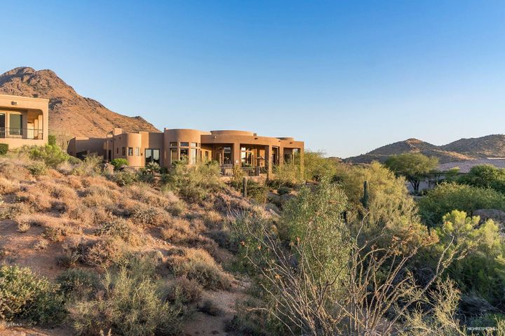 Perched high to capture all the beautiful views, boulder outcroppings, sunsets and mountain views!