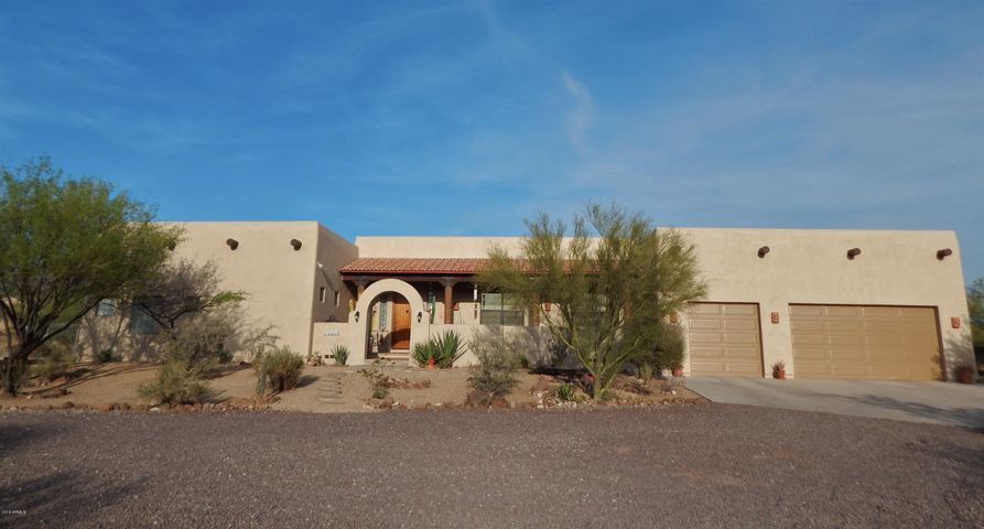 Front of house with arch, 3 car garage, spacious parking areas