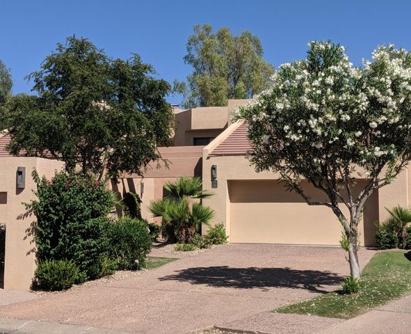 Attractive curb appeal with mature landscaping