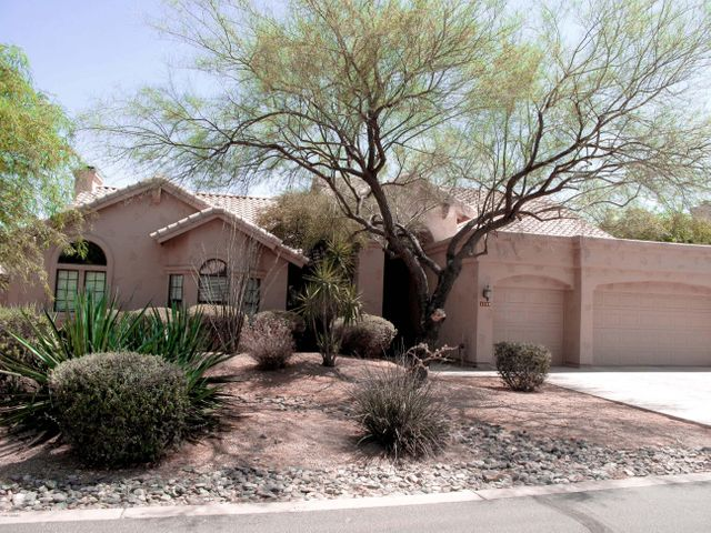 Four bedroom, 2.5 ba, 3 car garage home sits N/S in gated community