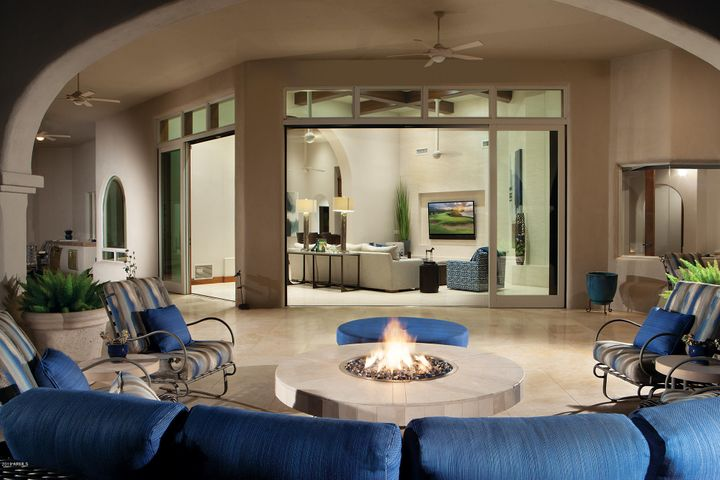 Telescoping doors off family room lead gracefully to the backyard