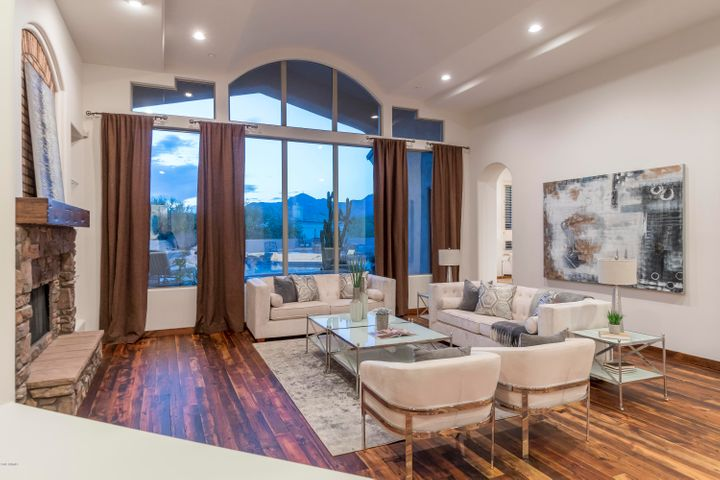An architectural beauty with sweeping McDowell Mountain views ~ note the gorgeous reclaimed barn wood floors