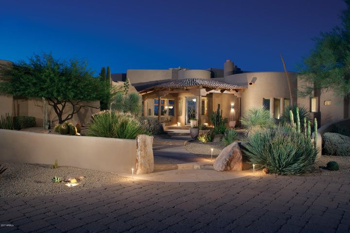 Privately gated community of 34, 4+ acre estates in North Scottsdale. This interior home site is perfectly positioned to embrace it's stunning surroundings, with views of Pinnacle Peak Mountain to the north and city light views to the south. The main house is 4282sf with 3 en-suite bedrooms and a spacious 3-car garage. The guest house is 1452sf and consists of 2- en-suite bedrooms. The current homeowners use the guest house as a one bedroom guest house with private entrance and it has a one car garage. The second guest house is used currently as an theater/game room with an air conditioned 2- car garage man cave.