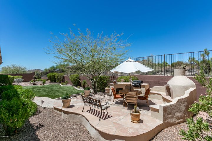 Enjoy the Mountain Views and Sunsets from this Raised Flagstone Patio with Outdoor Fireplace