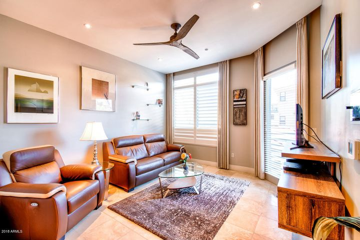 Nice size Living Room with Built in TV and Storage shelving and French door to Balcony