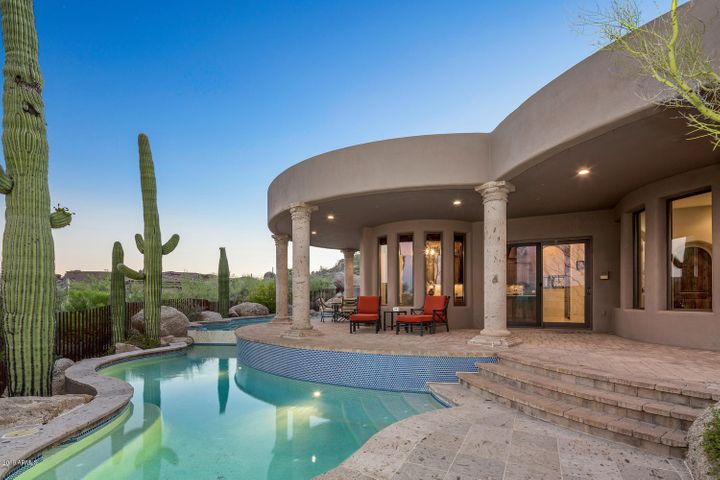 Expansive back patio with various outdoor spaces to enjoy the views and 2-level pool.