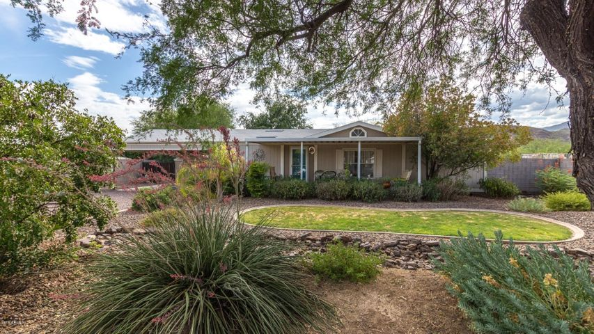 Beautifully Landscaped!! Large Covered Front Patio!!