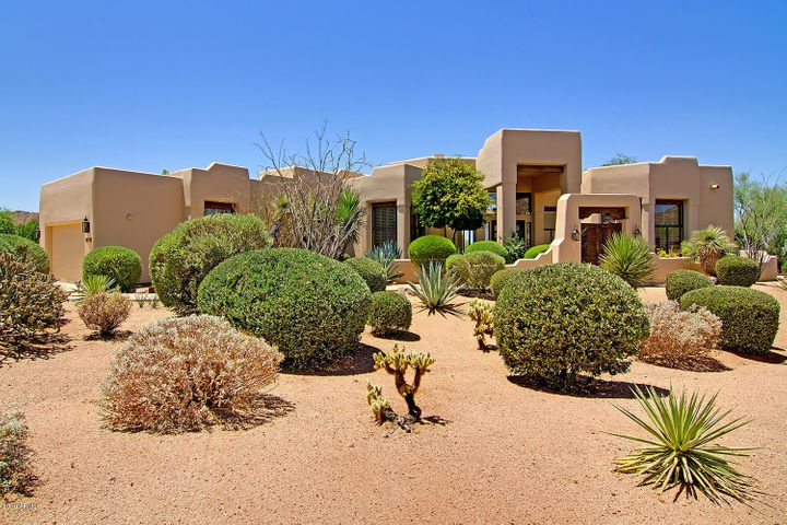 Beautiful curb appeal in a natural desert setting!