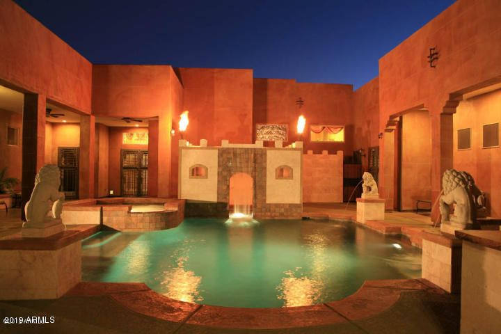 Resort style pool, water features, spa, courtyard