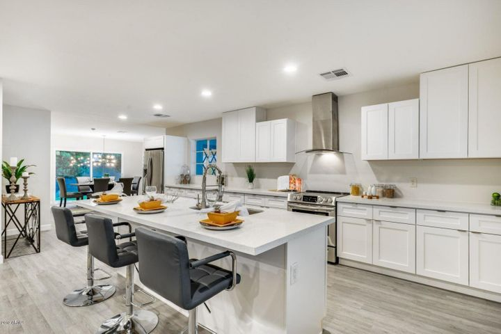 Kitchen with 9 foot quartz coutner tops with sink in the middle