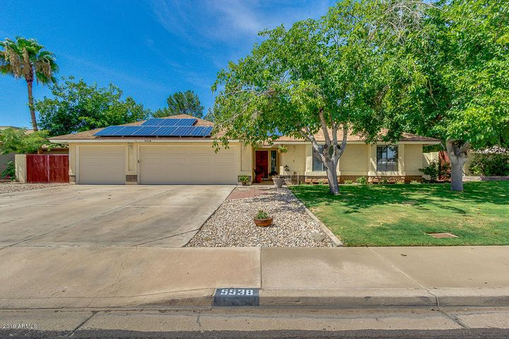 Curb appeal galore in this gorgeous well maintained gem with RV gate and owned solar creating a huge savings