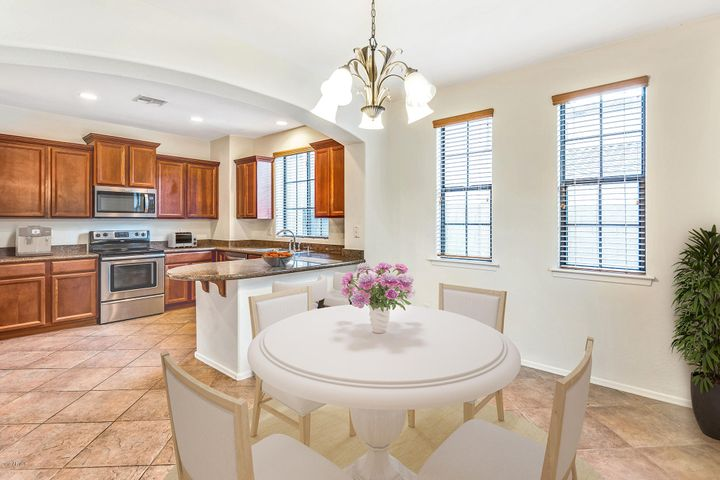 Spacious kitchen with formal dining area and breakfast bar.
