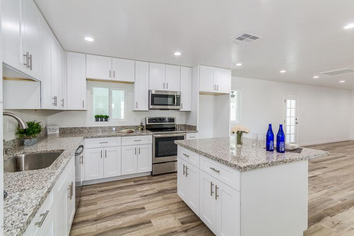 Enjoy your new granite counters, accented with brushed nickel fixtures. Plenty of storage space!