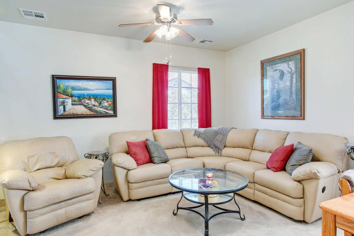 Loads of space. This main living room is open to the kitchen & dining areas for great entertaining or family time.