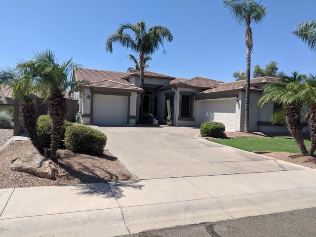 Front of home with beautiful curb appeal and 3 car garage.
