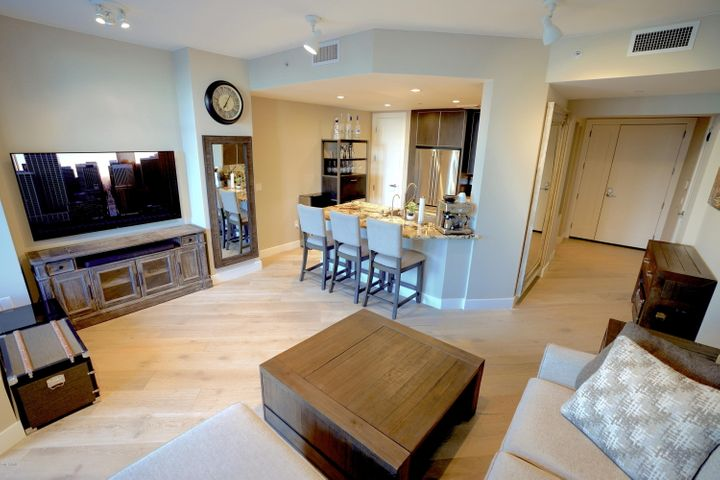 New Light Wood Flooring Throughout with Voice Activated Automated Blinds. Gas Fireplace!