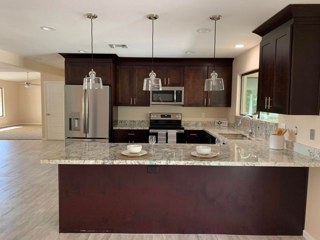 All new kitchen with cabinetry, new granite counter-tops and as well as new stainless steel appliances