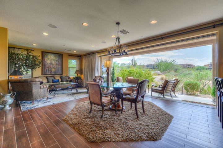 The wall of pocketing doors creates an easy flow for indoor and outdoor living.