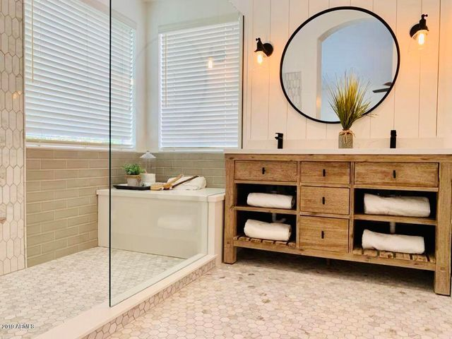 Master Bathroom is your own Spa, with New Tile, New Vanity, and New Lighting.