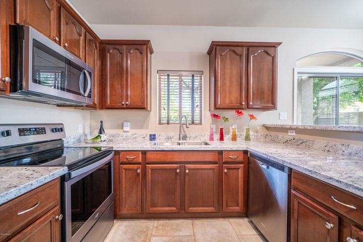 Beautiful and spacious kitchen perfect for making Sunday breakfast. ALL NEW STAINLESS APPLIANCES, GRANITE COUNTER, DISPOSAL, and UNDER MOUNT SINK