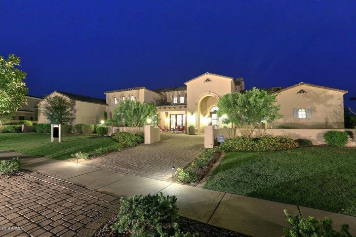 Private setting on a North/South waterfront lot in the gated Island at Fulton Ranch.
