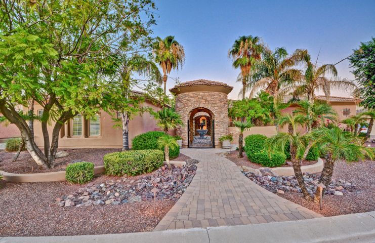 The inviting courtyard entry with fountain and gas firepit welcomes you into this exquisite home.