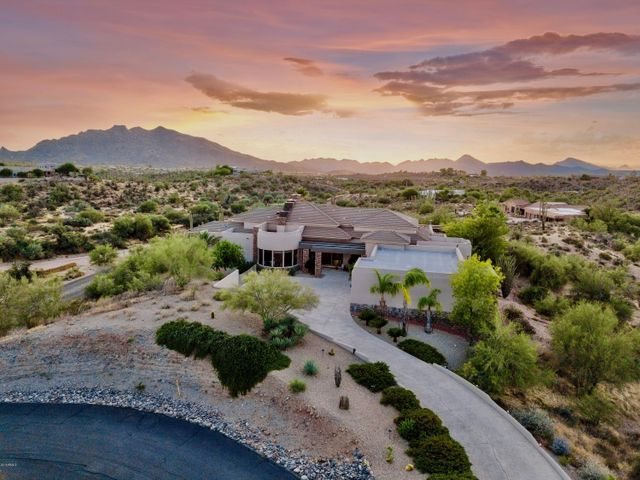 Serene and secluded, yet just minutes to the quaint and cowboy-chic downtowns of Carefree and Cave Creek