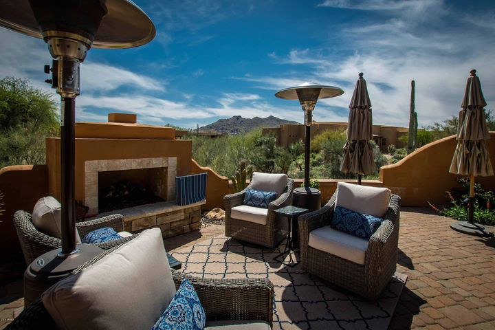 The Carefree way of life! Spacious view patio with motorized awnings, spa, dining and relaxing areas. This residence has a dream kitchen, see-through bar, massive Great Room and a separate casita with its own garage/workshop! This builder's home has lots of extra touches!